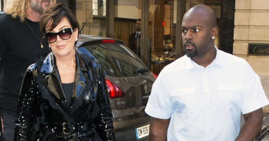 Kris Jenner Wears Black Patent Leather Trench Coat for Paris Fashion Week 2016