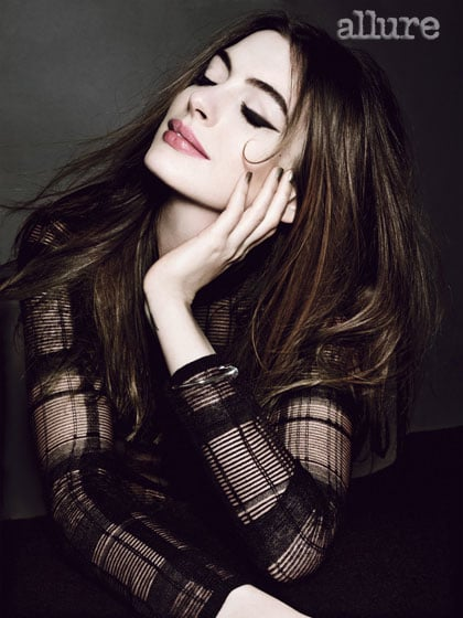 """Anne Hathaway shows off her dimples on the cover of Allure magazine's July issue, which hits newsstands today. She sported longer locks for the shoot, but actually buzzed off her hair last month for her role as Fantine in Les Misérables. Anne will also pop up on the big screen next month as Catwoman in the third and final installment of Christopher Nolan's Batman trilogy, The Dark Knight Rises. In the issue, Anne opened up about both roles and the changes she underwent for them. She spoke about shedding weight to play Fantine, what it took to wear the Catwoman suit, and being OK with nudity. Here's more from Anne Hathaway in Allure:  On her Catwoman suit: """"The Catwoman suit. It was a psychological terrorist. . . . The suit, thoughts of my suit, changing my life so I would fit into that suit . . . It dominated my year. I went into the gym for 10 months and didn't come out."""" On losing weight for her role in Les Misérables: """"I'm doing some crazy weight stuff right now. I'm on day six of detox. . . . This diet makes me break out, so I love that. Nothing like living on hummus and radishes and then be all, 'And I got a pimple. Yeah!'"""" On nudity: """"I'm as vain as the next girl, but I think it's my job to show people as they live, and nudity is part of life.""""  Photos courtesy of Tom Munro for Allure"""