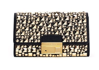 Michael Kors's studded pebbled clutch ($795) is super sexy and sleek and would surely make your arm sparkle all night.