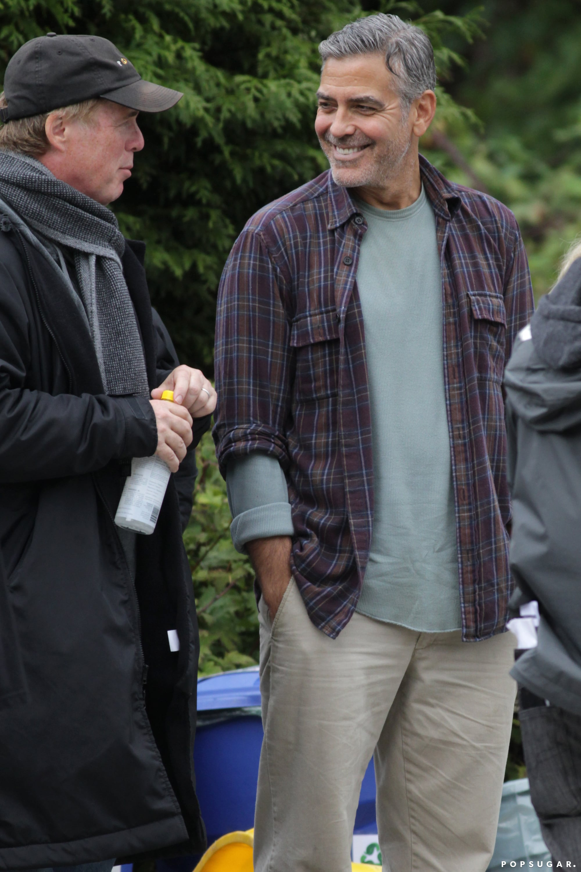George Clooney chatted with a crew member.