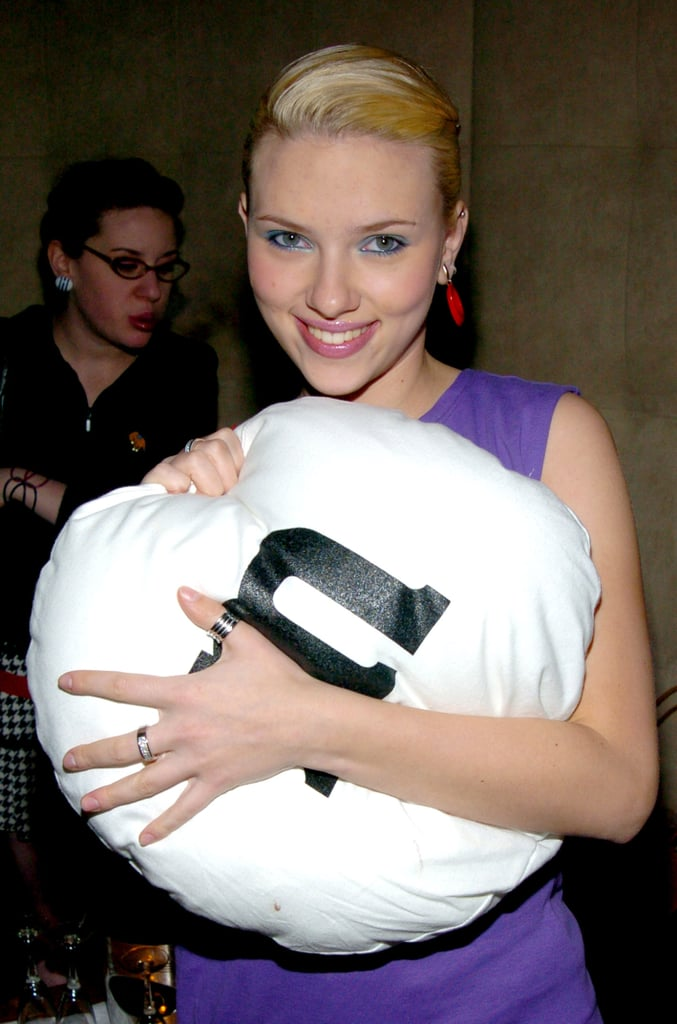 Scarlett hugged a giant M&M's pillow at an event in 2003.