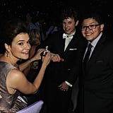 Betsy Brandt signed a cast for Modern Family's Nolan Gould while Nolan's costar Rico Rodriguez smiled big.