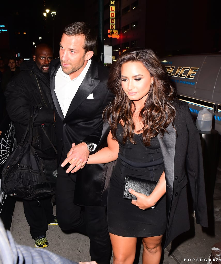 After months of speculation, Demi Lovato and UFC fighter Luke Rockhold appeared to confirm their romance when they were spotted holding hands in NYC on Saturday night. The singer, who was previously rumored to be dating John Mayer, looked calm and relaxed as she and Luke made their way into Madison Square Garden to watch the big fight between Connor McGregor and Eddie Alvarez. Demi dressed to the nines in a curve-hugging black dress, while Luke looked sharp in a black suit. Demi was most famously linked to Wilmer Valderrama, but the two called it quits in June after nearly six years of dating.      Related:                                                                                                           Love Is in the Air: All the New (and Rekindled) Celebrity Romances of 2016