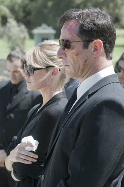 Laura Allen as Hannah and Jason Isaacs as Michael Britten in Awake.