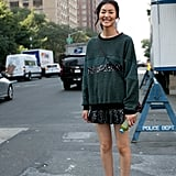 Liu Wen nailed the downtown-cool vibe in a sweater, a sequined mini, and ankle boots.