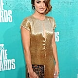 Nikki Reed rocked a gold dress on the red carpet.