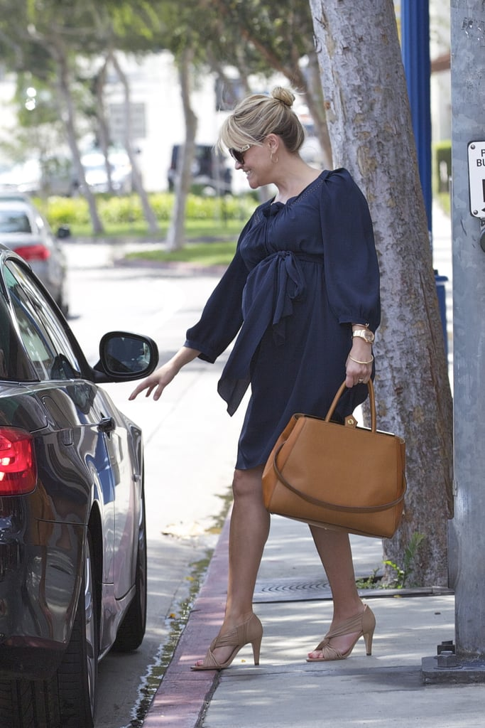 "Reese Witherspoon met up with a friend for lunch at Hugo's in LA yesterday. She covered her growing baby bump in a navy dress and carried a colorful bag. Reese may be hanging close to home in LA as she awaits the arrival of her third child, but her Ojai vacation house is getting plenty of attention as well. The getaway was featured in Elle Decor, with Reese sharing that the spot is ""meditative and restorative."" It's also apparently the location of Robert Pattinson's current hideout. He's staying there in the wake of the Kristen Stewart cheating scandal and was spotted running around the compound in recent weeks. Reese reportedly offered to let Rob visit, since the duo became friends while working on Vanity Fair and Water For Elephants together."