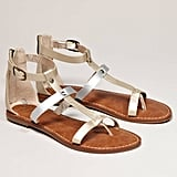 A pair of comfy sandals should be on the top of your list. Make sure they're slightly cushioned for maximum comfort. Sam Edelman for AEO Metallic Gladiator ($40)