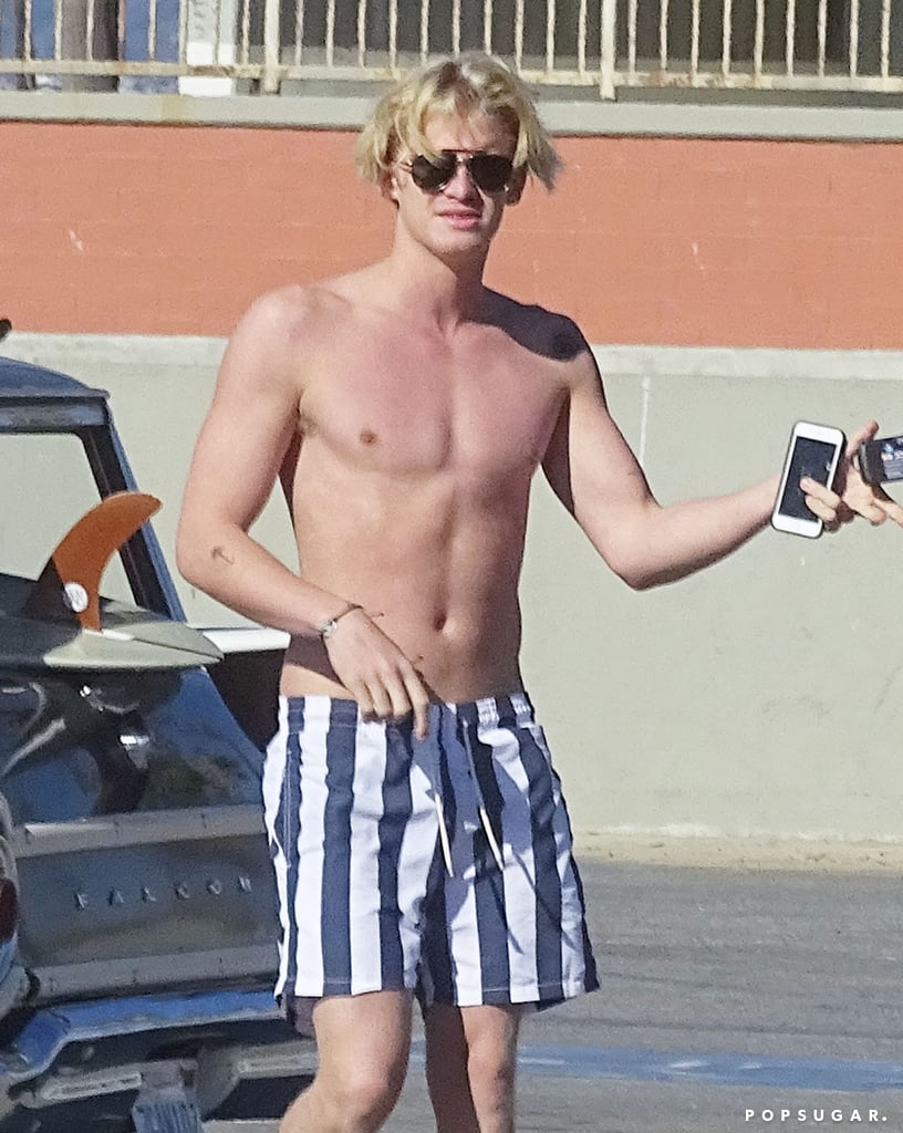 Cody Simpson showed off his chiseled, shirtless body during a beach day in LA on Friday. The 18-year-old singer hit the waves for a surf session before heading back to shore and snapping photos with his friends and his vintage car. Earlier this month, Cody returned to his native Australia and performed at Hill Square for Emirates Stakes Day and made a handsome appearance at GQ's Men of the Year Awards in Sydney, Australia. Keep reading to see Cody's superhot beach photos, and then check out the sexiest shirtless moments of 2015.