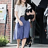 Kate Winslet wore a knee-length purple skirt on the set of Labor Day.