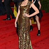 Jessica Paré wore a beautiful metallic gold gown.