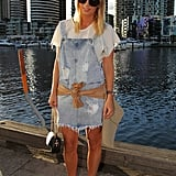 This girl's ripped overalls dress was clearly the most eye-catching piece in her look, but we love how her polished add-ons played opposites.