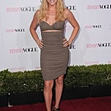 Brittany Snow showed off her sexy side in a Michael Kors taupe jersey bandeau dress, Michael Kors bronze lizard platform sandals, and a Michael Kors python envelope clutch.