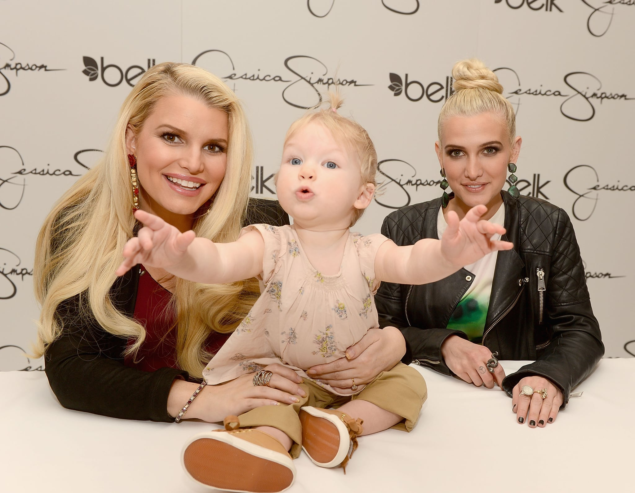 Jessica Simpson and Ashlee Simpson posed with Maxwell Johnson during a promotional stop in Charlotte, NC.