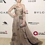 Wearing a Paolo Sebastian gown with a Tyler Ellis pouch at the Elton John AIDS Foundation party in 2018.