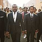 And smartly dressed in a '60s suit in Selma.