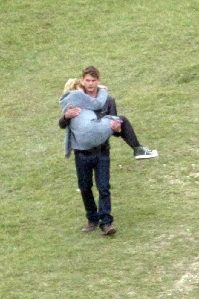Dakota Fanning held onto Jeremy Irvine.