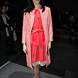 Leigh Lezark continued to explore her colourful side in a bright pink dress combo and sweet white sandals at Giambattista Valli