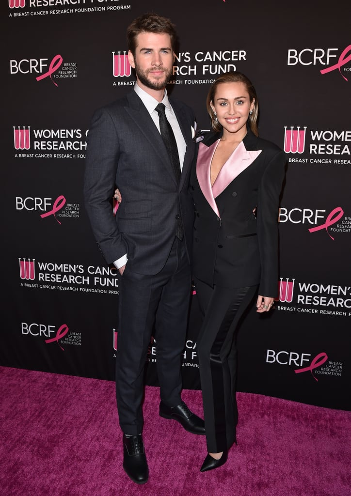 "Miley Cyrus and Liam Hemsworth hit the red (OK, pink) carpet when they stepped out in support of the Women's Cancer Research Fund at the ""An Unforgettable Evening"" Benefit Gala. The couple looked adorable dressed in their his-and-hers suits, but we have to confess a particular love for Miley's chic Tom Ford design.  It's not the first time Miley's chosen a pantsuit for a big event, but while her last one had an exaggerated silhouette, this look was more sharply tailored. The double-breasted tuxedo jacket's pink lapels added a feminine touch, but rather than going overboard in the glamour stakes, Miley instead worked the androgynous look by adding pointed-toe pumps and slicking her hair back in a wet-look style.  The suit may be a million miles from the plunging, sequined Saint Laurent gown she chose for the Oscars, but the finished effect was just as striking. Keep reading to take a closer look.      Related:                                                                                                           Miley Cyrus Is Fully Committed to Showing Us Every Angle of Her Sexy Dresses This Year"