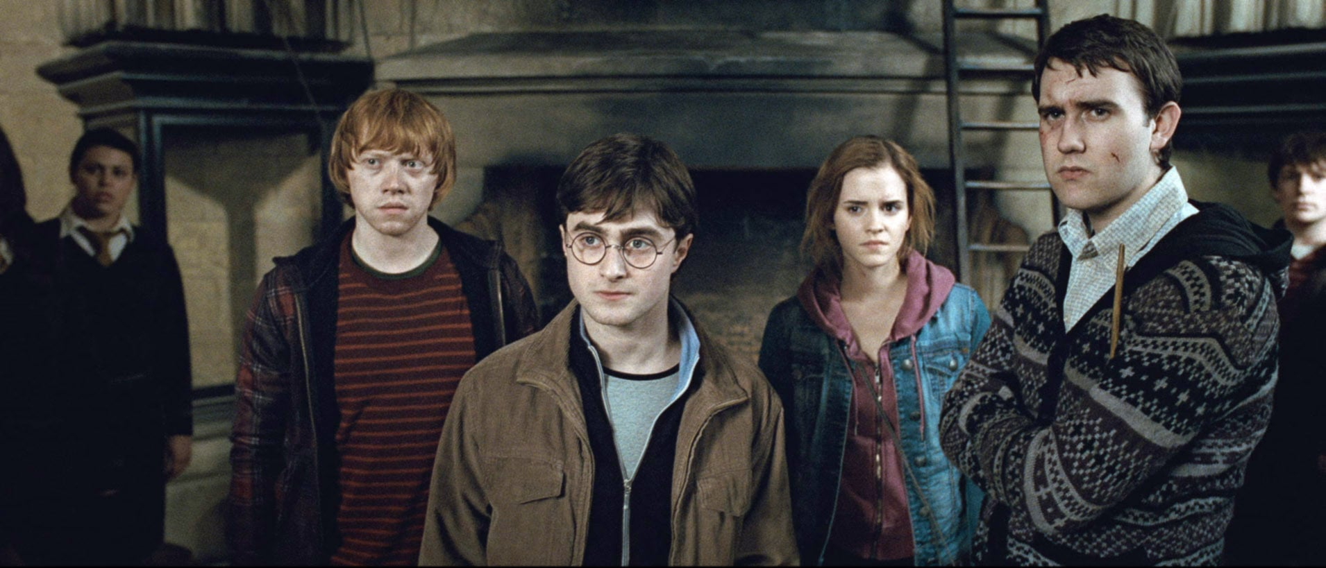 HARRY POTTER AND THE DEATHLY HALLOWS: PART 2, from left: Rupert Grint, Daniel Radcliffe, Emma Watson, Matthew Lewis, 2011. 2011 Warner Bros. Ent. Harry Potter publishing rights J.K.R. Harry Potter characters, names and related indicia are trademarks of and Warner Bros. Ent. All rights reserved./Courtesy Everett Collection