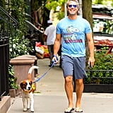 "Leave it to Andy Cohen to channel Ross on his daily walk in NYC. By wearing this vintage-inspired Snoopy shirt, he is pulling off the ""Frankie Says Relax"" style, but it actually fits him."