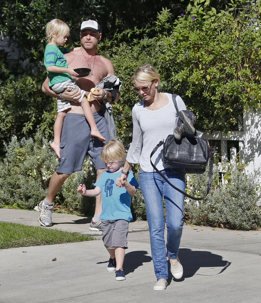 Naomi Watts held her son's hand (with shirtless partner Liev Schreiber behind her) after leaving Simon Baker's place in Santa Monica on Jan. 20.