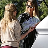 Jessica Alba looked at a nicely wrapped gift.