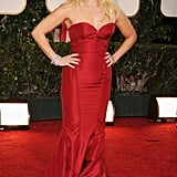 Reese Witherspoon wore a red Zac Posen gown on the red carpet.