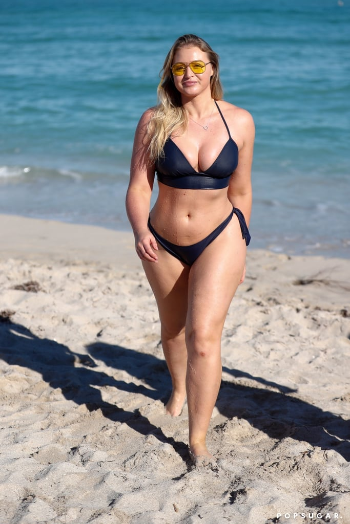 Model Iskra Lawrence continued her tropical Miami getaway with a sexy day at the beach on Monday. The English model appeared to be in a bubbly mood — and likely turned heads — as she walked across the sand in a navy blue bikini with high-cut legs and took a dip in the water with a friend. Iskra touched down in Miami after a quick trip to Tulum, Mexico, last week and hosted an in-store event for Aerie as the brand's global role model. Keep reading for Iskra's latest bikini photos, then check out her hottest Instagram snaps.      Related:                                                                                                           2017's Sexiest Bikini Moments Are Guaranteed to Keep You Warm All Through Next Year