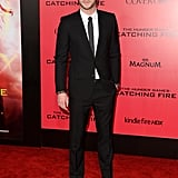 Liam Hemsworth wore a black suit.