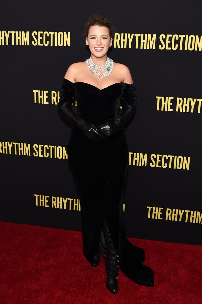 Blake Lively brought absolute elegance to a Rhythm Section screening in NYC on Monday night. The 32-year-old actress made her return to the red carpet after giving birth to her third daughter with Ryan Reynolds, and she looked every inch a glam goddess in a fitted velvet gown and over-the-knee boots.  As if the dress wasn't show-stopping enough, Blake also upped the Old Hollywood vibes with a massive pearl statement necklace. She tied everything together with dramatic black gloves, diamond earrings, and a sophisticated updo. Serena Van Der Woodsen would be so proud! This is definitely an outfit the Upper East Side queen would wear. See more glimpses of Blake's red carpet ensemble ahead.