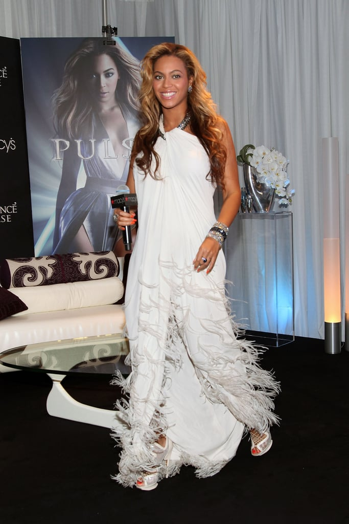 Pregnant Beyoncé Knowles Stuns in a White Lanvin Gown While Promoting Her New Scent