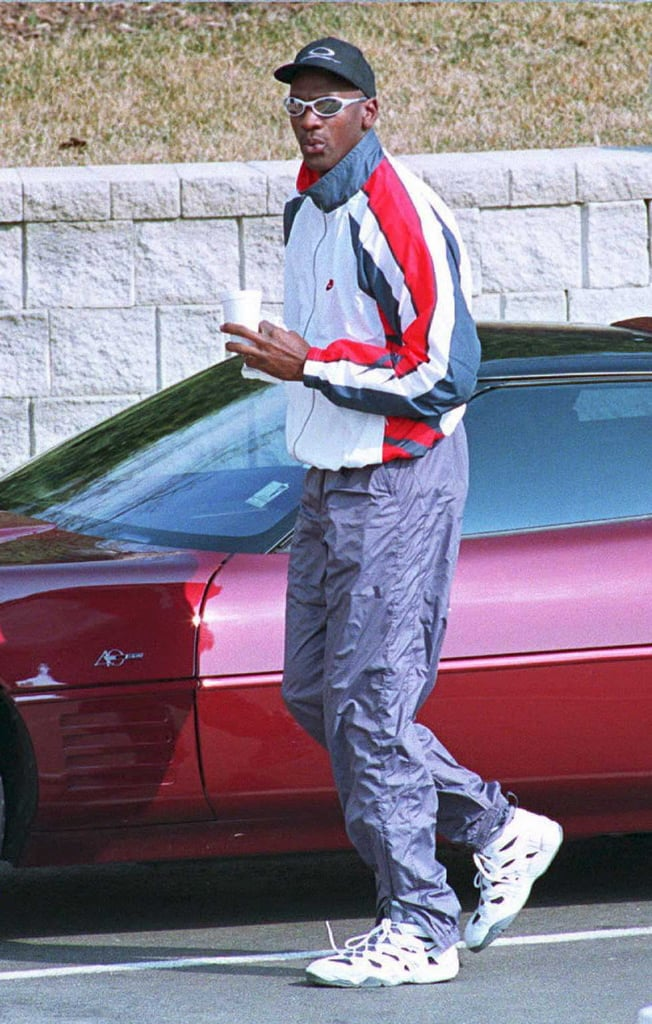 Michael pulled up to Chicago Bulls practice in 1995 wearing a windbreaker jacket and pants — what a time — with a baseball hat, futuristic sunglasses, and, of course, Nike sneakers.