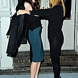 Stella McCartney helped Liv Tyler out of her coat.