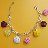 A bracelet for a little arm candy.  Concha Pan Dulce Charm Bracelet ($27)