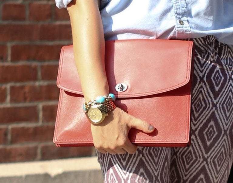 This streamlined clutch added a classic contrast to printed skinnies. Greg Kessler