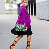 Put on a pleated skirt with a blazer in an eye-catching color, then match your patterned accessories.