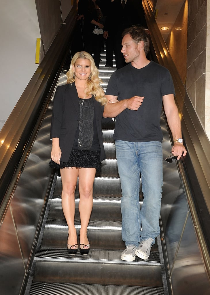 "Jessica Simpson brought her fiancé Eric Johnson along Saturday for a visit to the Macy's in San Francisco. She was on hand to launch her new ready-to-wear collection, which will be sold in the retailer's shops across the country. She focused on work despite the many rumors flying around about her personal life that suggested that she's either pregnant or postponing her wedding. Whether kids are in her immediate future, Jessica seemed happy to meet with her young fans including one adorable baby. Business didn't get in the way of Jess having a relaxing afternoon today, though. She tweeted, ""Already went for a hike, bought out the grocery store, and ate a bowl of Capt'n Crunch. . . Now it is time for some football! Go Cowboys!"""
