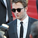 Robert Pattinson donned a pair of sunglasses at the On the Road premiere at the Cannes Film Festival.