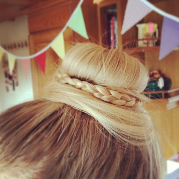 This layered bun was gorgeously accented with a dainty braid. Source: Instagram user livijade101