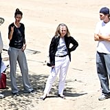 Gisele Bundchen and Tom Brady consult with contractors.