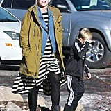 The ski jacket works for real life, too, worn layered over a striped dress and Paige denim vest.