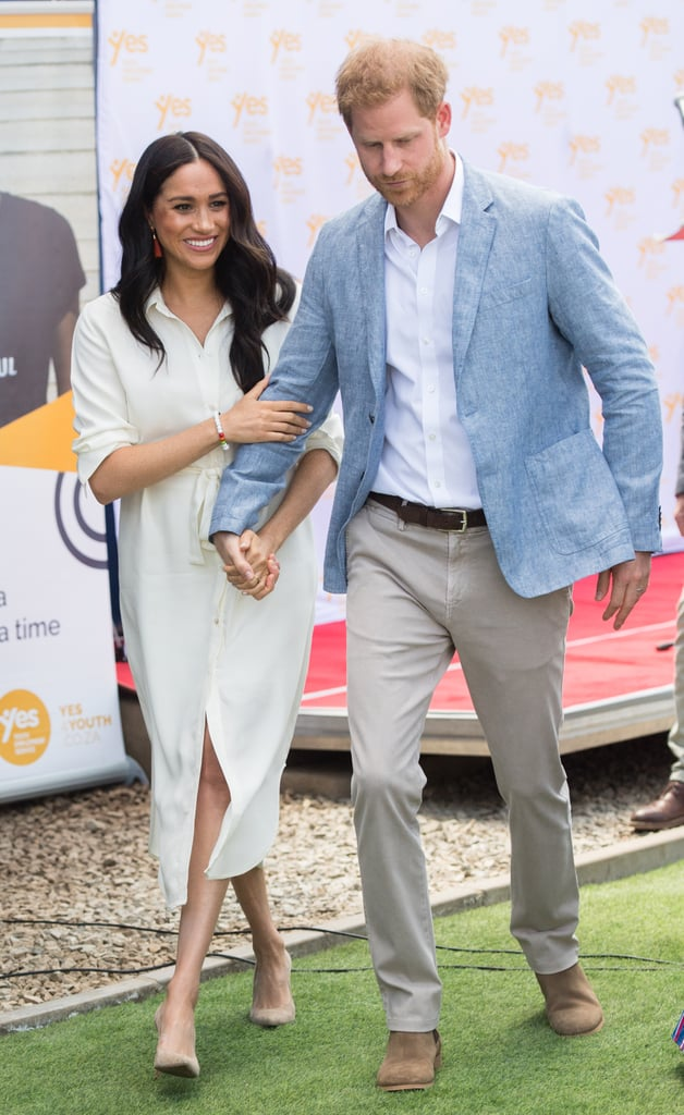 Meghan Markle Holds Hands With Prince Harry in a White Dress