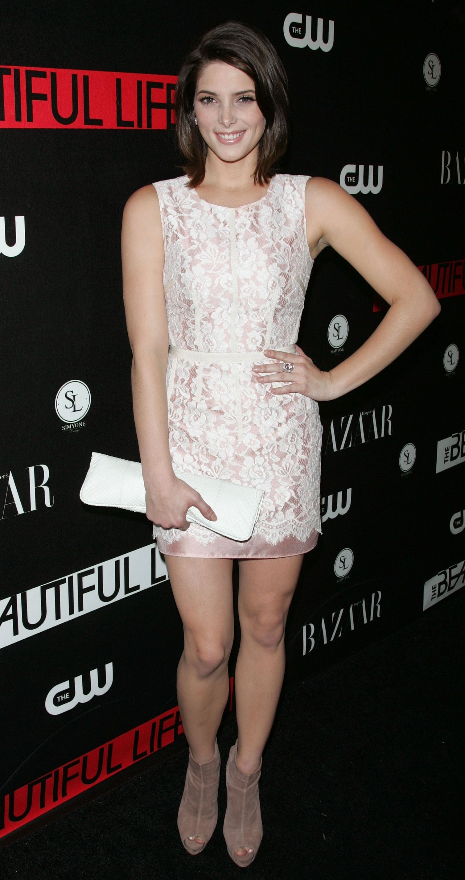 Stepping out for a CW party in a white lace LWD in 2009.
