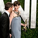 Anne Hathaway laughed as she arrived at the Vanity Fair Oscar party.
