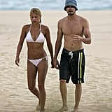 Anna Kournikova wore a white bikini to hit the beach in Mexico with Enrique Iglesias in October 2004.