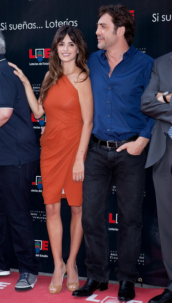 Penelope Cruz looked red hot in a sexy Roksanda Ilincic dress for Madrid's Walk of Fame induction ceremony today. She was joined by her handsome husband, Javier Bardem, who looked on with pride while she accepted her honor and later knelt down for photos with his own prestigious star. Spain's Walk of Fame, which officially opened today, recognized 25 of the country's actors and directors, like Penelope and Javier's close friend Pedro Almodovar and Antonio Banderas. Today's event marks her second accolade of the year after Penelope received a star on Hollywood's Walk of Fame in April. Penelope and Javier's number one fan, their 6-month-old son Leo, wasn't in attendance for the event, though he did get a visit recently from his uncle Eduardo who brought girlfriend Eva Longoria home for a few days.