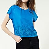 Dress up a more casual look with texture — this bold cobalt blue leather t-shirt surprises with a subtle cutout detail at its hem. Warehouse Cutwork Leather T-Shirt ($40)