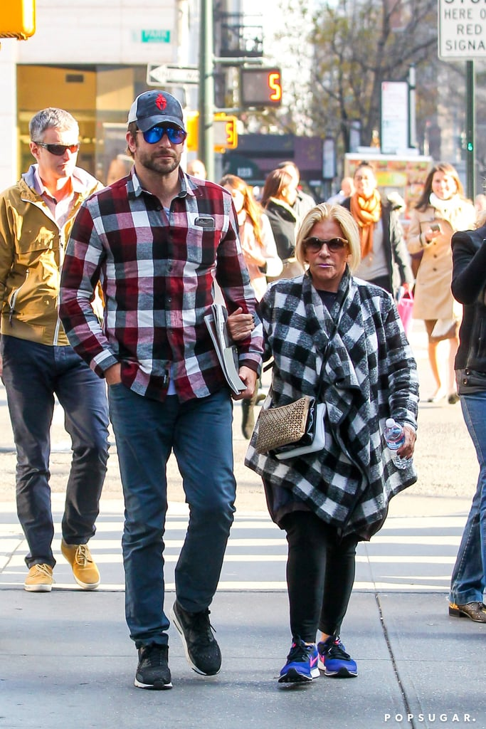 """Bradley Cooper and his mom, Gloria Campano, were spotted taking a stroll together in NYC on Thursday. The actor towered over his adorable mother as they made their way down the street, and the two looked so cute in their matching buffalo plaid tops. We last saw Bradley out and about when he attended the GQ Men of the Year party earlier this month; he mingled with Jon Hamm and reunited with his """"fiancée"""" Amy Schumer, which made for some truly hilarious photo ops. Keep reading to see Bradley in the Big Apple with his mom, then watch the trailer for Joy, which he stars in with Jennifer Lawrence and Robert de Niro."""