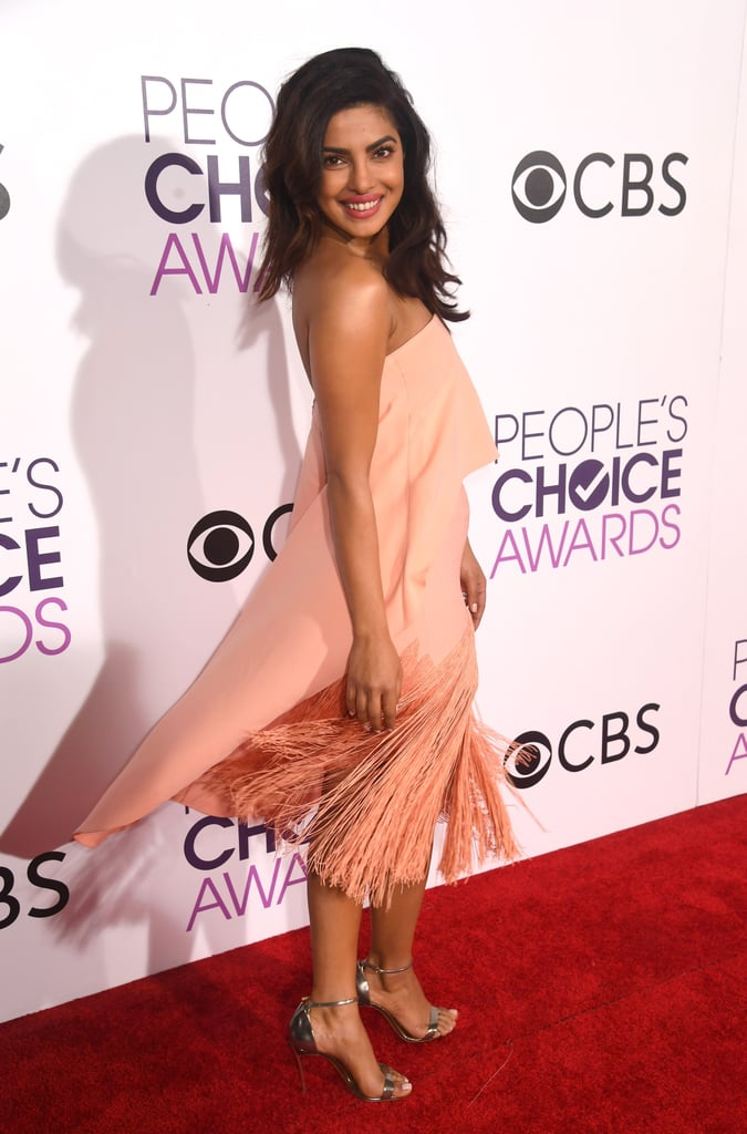 Priyanka Chopra had Quantico fans worried last week when she was hospitalized after suffering a terrifying fall on the set of the FBI drama. Thankfully, it looks like she's recovered just fine! The 34-year-old actress rolled up to the People's Choice Awards on Wednesday night in LA looking like a breath of fresh air, twirling her way down the red carpet in a gorgeous peach dress and flashing a big smile for photographers. She later accepted the award for best dramatic TV actress, where she took the opportunity to continue wiggling onstage. Although she didn't bring new BFF Sofia Vergara as her date, it looks like Priyanka still had a total blast rolling solo.      Related:                                                                Quantico's Top-Secret Spy Organization Is Way More Real Than You Thought                                                                   Priyanka Chopra's Pink Makeup Is Exactly How You Want Your Face to Look                                                                   Look Back on the People's Choice Awards Red Carpet Style From Last Year